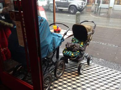 Babies left outside while people shopped or ate